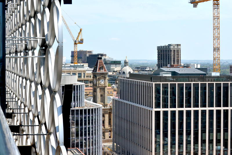 Rooftops and cranes viewed from the roof garden of the Library of Birmingham