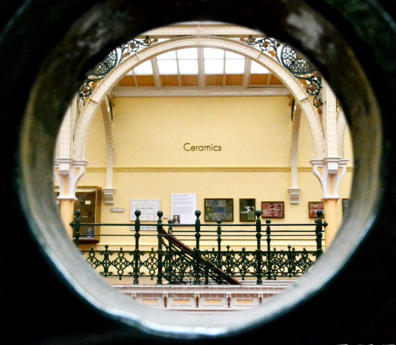 View of one of the galleries at Birmingham Museum and Art Gallery through a circular hole