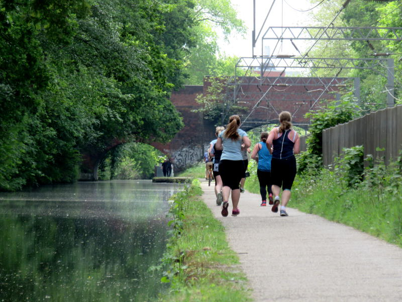 Runners on the canal towpath