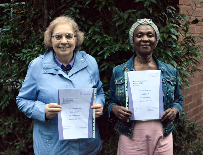 Miriam and friend Ann holding 3D certificates