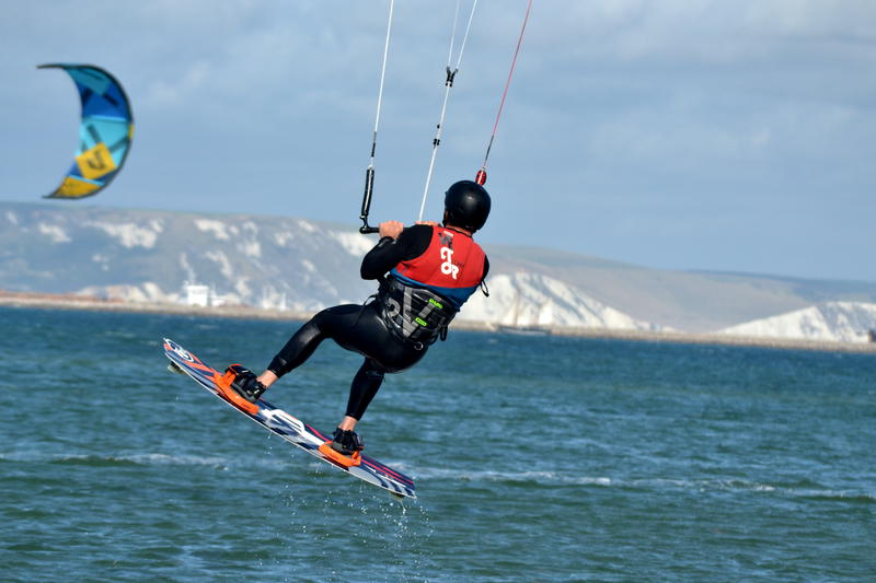 Kitesurfer taking off from the sea