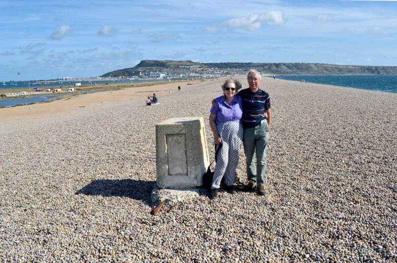 Miriam and Phil on top of the shingle ridge of Chesil Bank