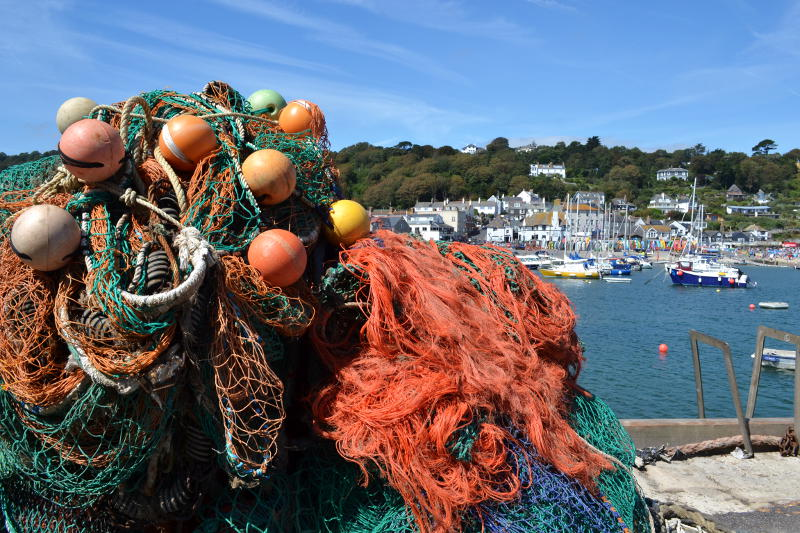 Coloured fishing nets with the harbour and town in the background
