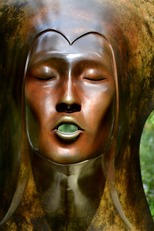 Bronze face at Sculpture by the Lakes