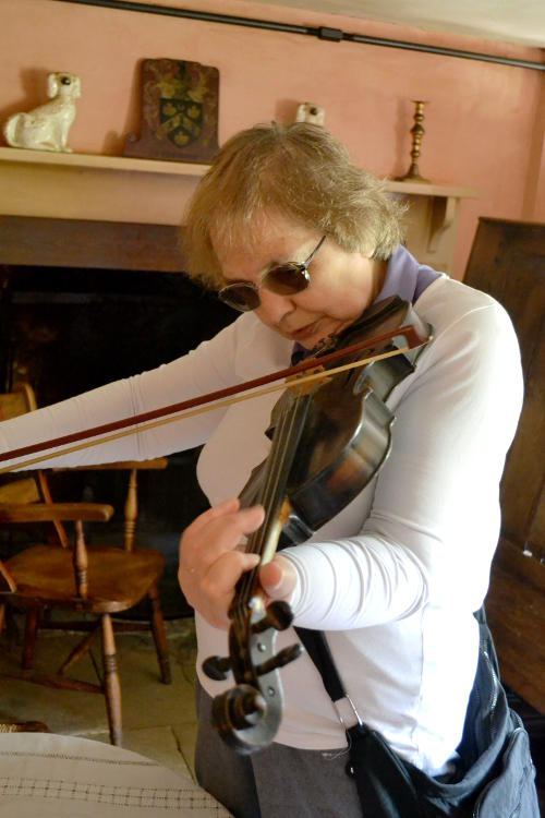 Miriam playing a violin