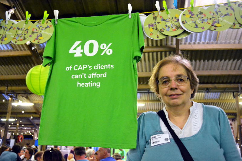Miriam with a banner: 40% of CAP's clients can't afford heating