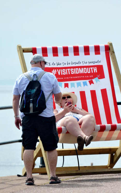 A woman in a giant deckchair