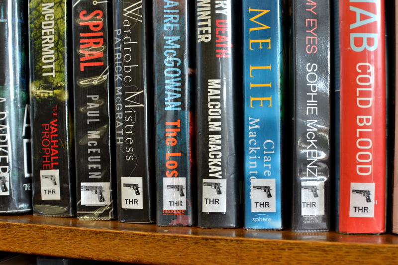 A row of thrillers on a library shelf