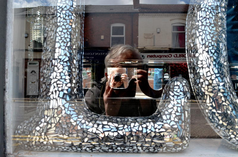 Reflection with a camera in a shop window