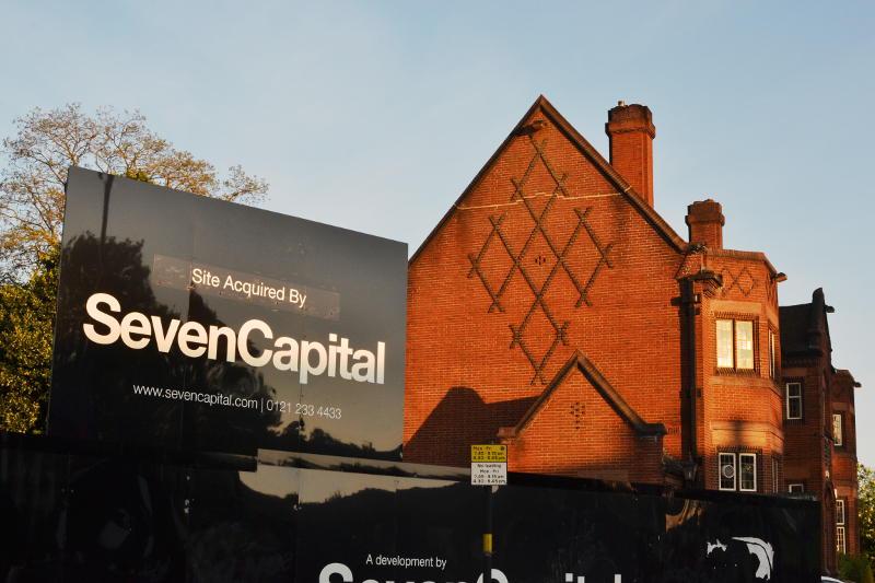 A Seven Capital hoarding alongside the British Oak pub