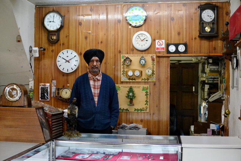 A watch and clock maker in his shop