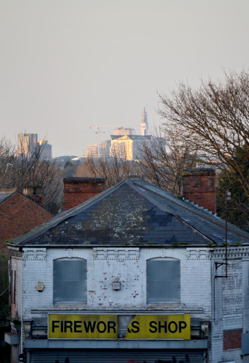 In the distance the Cube is lit up by evening sunshine, while the derelict fireworks shop dominates the foreground