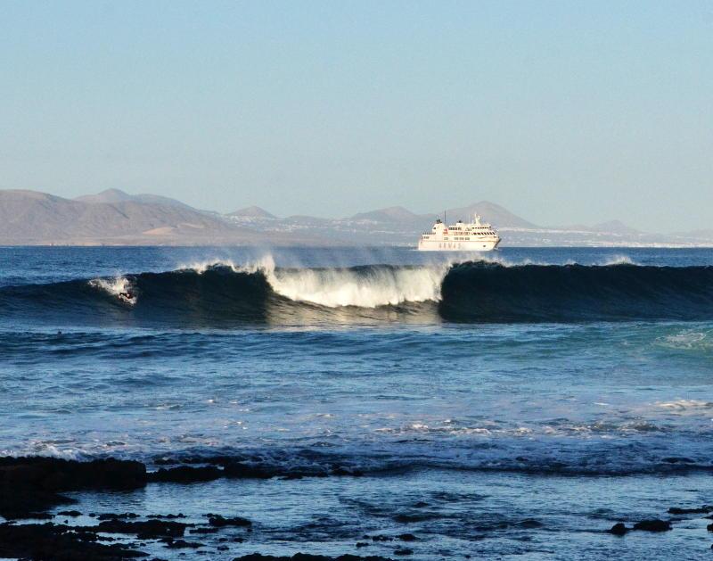 A ferry through a gap in the waves