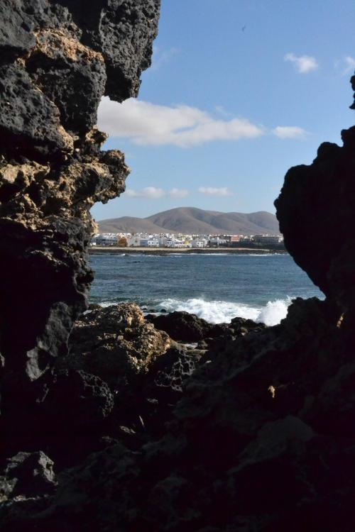 View of the sea between rocks at El Cotillo