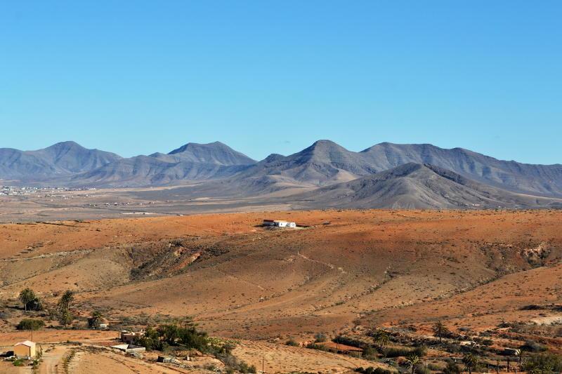View towards mountains across a barren valley