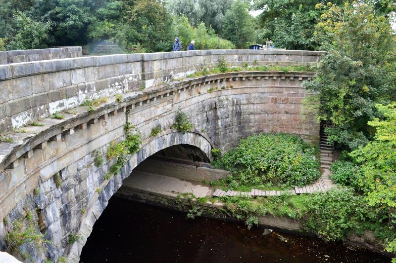 A stone aqueduct over a river