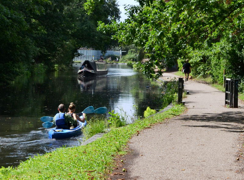 A rowing boat and a narrowboat on the canal